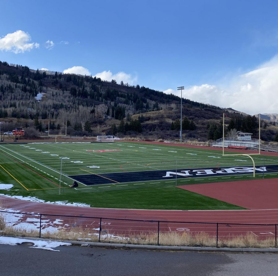 Aspen School District turf with some snow on it, causing outdoor sports practices to be stopped