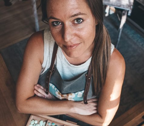 Kate Flynn, a local artist in residency at the Red Brick, poses in her studio.