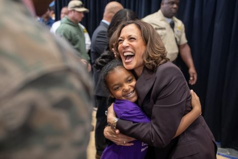 Kamala Harris hugs a child.
