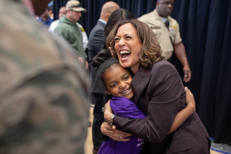 Kamala Harris hugs a child.