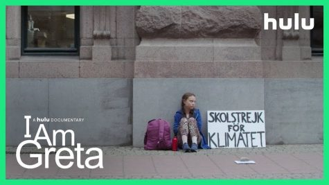 Greta Thunberg sits outside of the Swedish Parliament in the poster for the 2020 Hulu film I am Greta.
