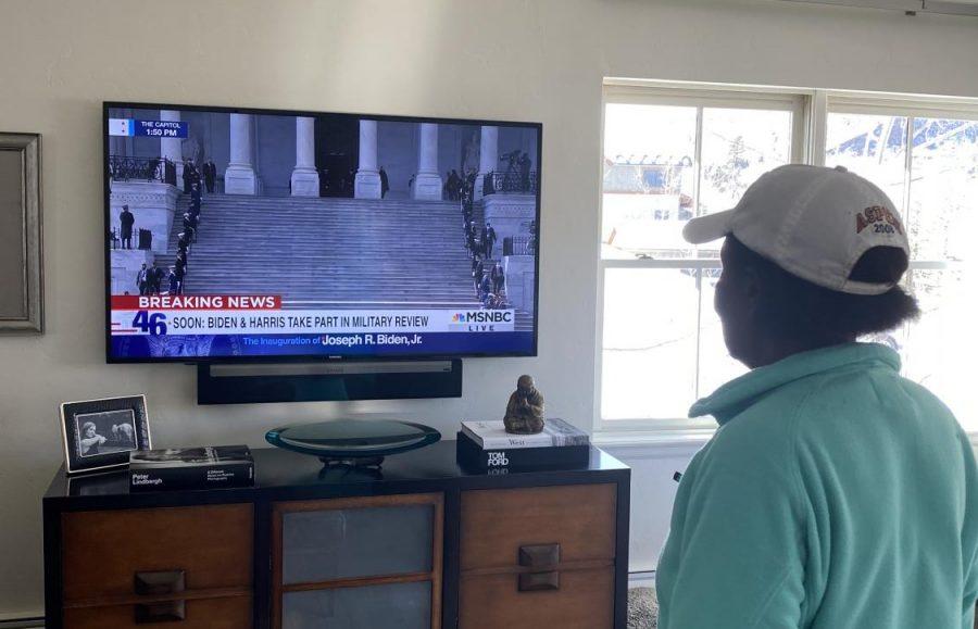 A Snowmass Village local, Zena Rashford, watches as President Joseph R. Biden is inaugurated.