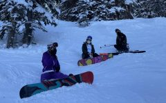 Carolyn Tanner, Gabi Echegaray, and Hannah Zack skiing and snowboarding at Snowmass Mountain while maintaining safety precautions.