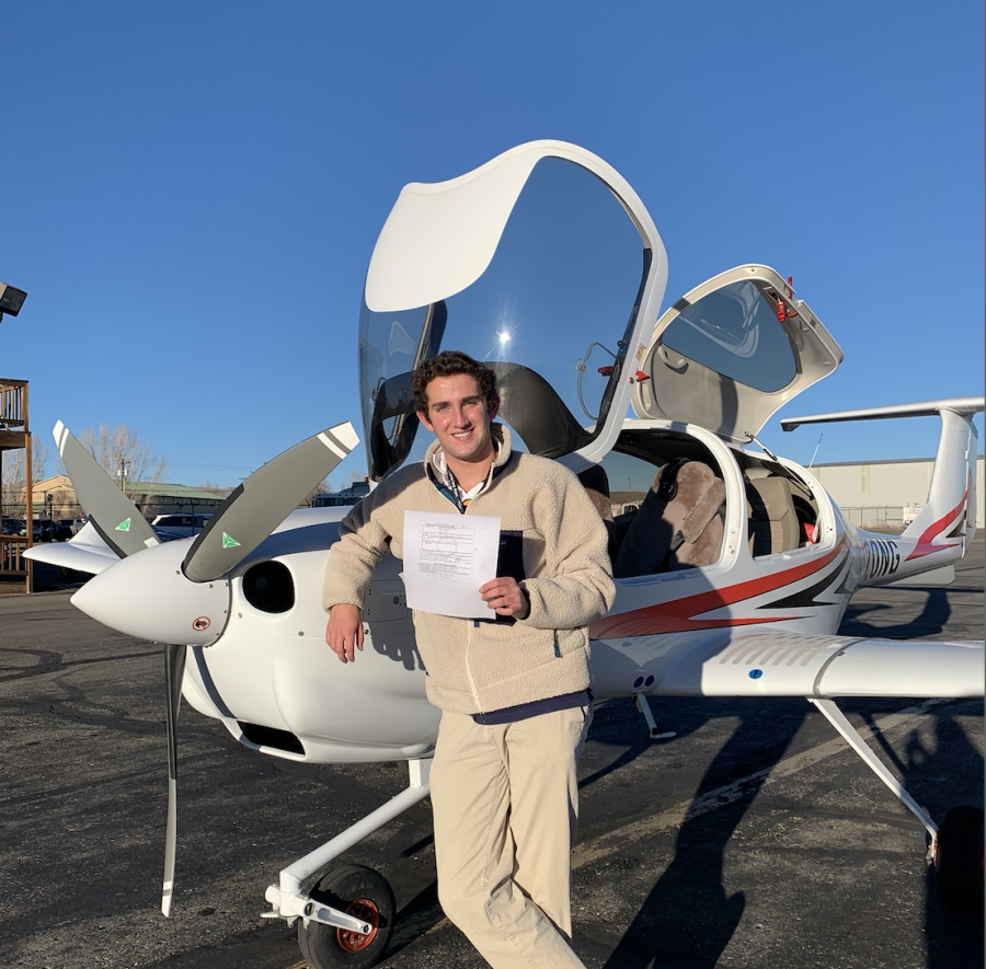 AHS+junior+Robert+Holton+posing+with+his+new+Private+Pilot%27s+license+by+an+AHS+plane.+