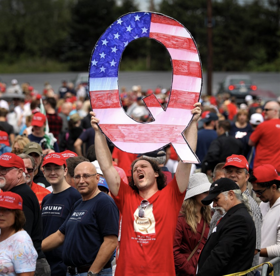 QAnon member at a Trump rally showing his support for the movement.