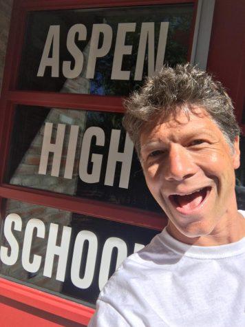 Berg poses outside the Aspen High School.