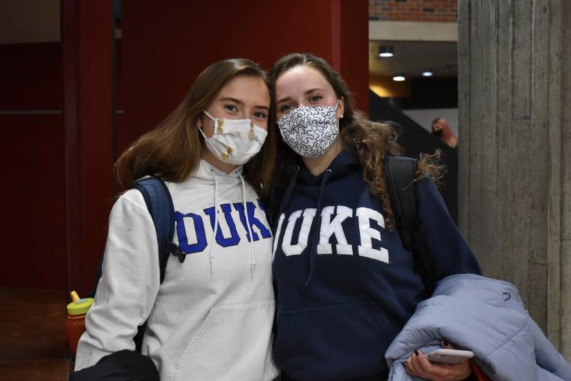 AHS seniors, Grace Romero and Caprice Seeman, wearing Duke sweatshirts on college commit day.