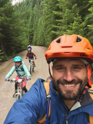 Zevin biking with his kids.