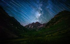 Time lapse photo of starry night sky over Maroon Bells in Aspen. Because there is little light pollution at the Bells, stars are very visible.