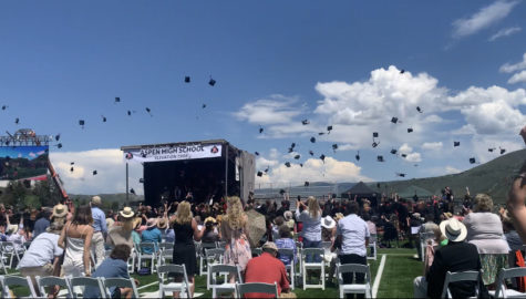 AHS Graduates throw their caps at the conclusion of the graduation ceremony on June 5, 2021.